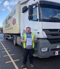 Steve Jones holding his C+E pass certificate.