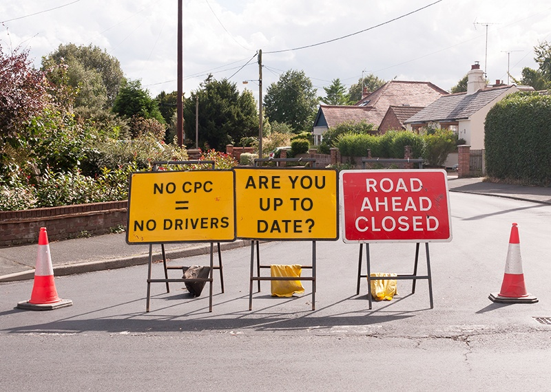 "picture of road signs with words ""no cpc = no drivers"" and ""are you up to date?"" and ""road ahead closed"""