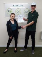 jamie makin holding his pass certificate with bridgwater branch manager amy manson.