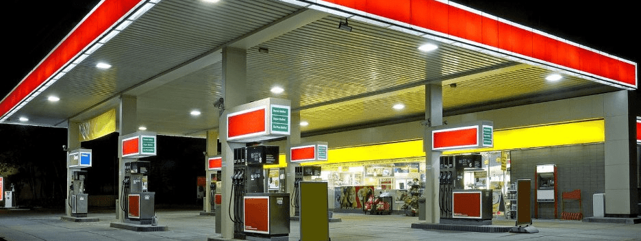 picture of a fuel forecourt at night
